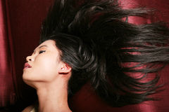 Asian woman with long hair Stock Images