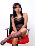 Sexy Asian woman sitting on office chair Stock Photo
