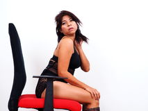 Sexy Asian woman sitting on office chair Stock Photography
