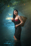 Asian women standing in creek. Asian woman standing in creek. Retro portrait. wear a skirt to cover her breast stock photos