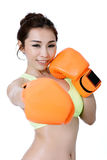 Sexy asian young women slim fit wearing orange mitt boxing on wh Royalty Free Stock Image