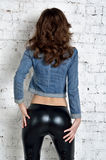 Sexy ass in black tights made of latex Royalty Free Stock Photos