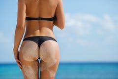 Sexy ass women with beautiful shape on the beach. Stock Photo
