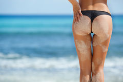 Sexy ass women with beautiful shape on the beach. Stock Images