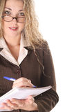 Sexy assistant taking notes. Shot of a sexy assistant taking notes Royalty Free Stock Photo