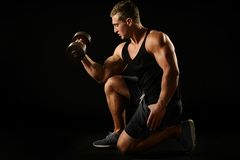 Sexy athlete with dumbbel Royalty Free Stock Photography