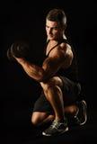 Sexy athlete with dumbbel Stock Image