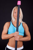 Sexy athlete holding a bar Royalty Free Stock Image