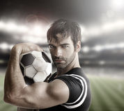 Athlete. Muscular man athlete with ball stock image