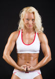 athlete showing her muscles Stock Photo