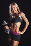 athletic blonde with dumbbells Royalty Free Stock Image