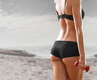 Sexy, athletic, blonde woman in the gym, against the background Stock Image