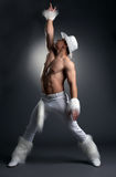 Sexy athletic dancer in white cowboy costume Stock Images