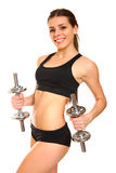 Sexy athletic girl with two dumbbells on a white background Royalty Free Stock Photo