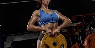 athletic girl working out in gym stock photos