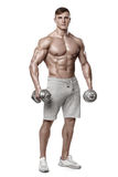 Athletic man showing muscular body with dumbbells, full length, isolated over white background. Strong male naked torso abs. Athletic man showing muscular body royalty free stock photos