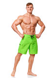 Sexy athletic man showing muscular body, isolated over white background. Strong male nacked torso abs Stock Images