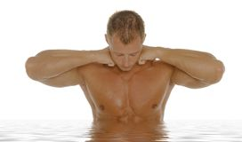 Sexy athletic man in water Stock Photo