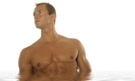 Sexy athletic man in water Royalty Free Stock Image