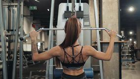 Professional athletic trainer sport girl with perfect fitness body doing workout hard training with bar on incline bench. Sexy athletic sport girl with perfect stock video