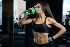 athletic young girl takes sport nutrition royalty free stock images