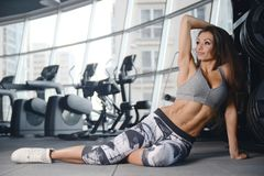 Sexy athletic young girl working out in gym Stock Photography