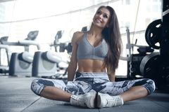 Sexy athletic young girl working out in gym Royalty Free Stock Image