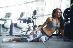 Sexy athletic young girl working out in gym Stock Photos