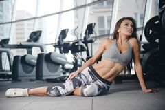 Sexy athletic young girl working out in gym Royalty Free Stock Photo
