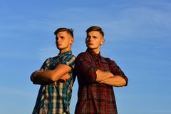 Sexy athletic young men twins brother. Posing in shirt stock image