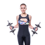 Sexy athletic young woman with perfect strong muscular body wearing sportswear tracksuit pumping up muscles with dumbbells isolate Royalty Free Stock Photography