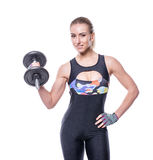 Sexy athletic young woman with perfect strong muscular body wearing sportswear tracksuit pumping up muscles with dumbbells isolate Stock Photos