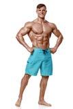 Sexy athletischer Mann, der den muskulösen Körper, lokalisiert über weißem Hintergrund zeigt Starker Mann nacked Torso-ABS Lizenzfreies Stockfoto