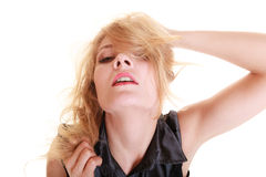 Sexy attractive blonde woman pulling her messy hair Stock Photography