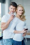 Sexy attractive couple drinking red wine Stock Images