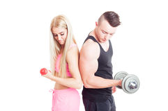 Sexy and attractive fitness couple holding weights Royalty Free Stock Image