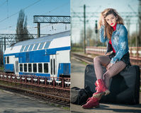 attractive girl with red head boots posing on the platform in railway station. Blonde woman in blue jeans jacket sitting Stock Photography