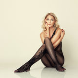 Sexy attractive girl in stockings pose on floor Royalty Free Stock Photo