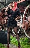 Sexy attractive girl waiting for landing on the platform in the vintage train Stock Images
