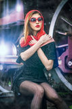 attractive girl waiting for landing on the platform in the vintage train Stock Photo