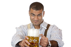 attractive man holds Oktoberfest beer stein Royalty Free Stock Images