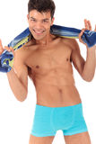Sexy attractive Nepalese male swimmer,. With towel around neck smiling. Studio shot. White background Royalty Free Stock Photos