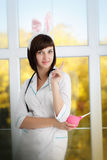 Sexy attractive nurse in a dressing gown with ears of rabbit Stock Images