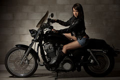 Sexy attractive twenties asian woman. Sitting on motorcycle Royalty Free Stock Images