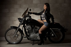 Sexy attractive twenties asian woman. Sitting on motorcycle Stock Photo