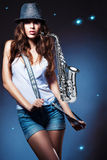 Sexy attractive woman with saxophone Stock Photos