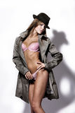 Sexy autumn fashion. Sexy woman in pink underwear and topcoat with hat, studio white Royalty Free Stock Photos