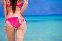 Sexy back of beautiful woman in red bikini on sea Royalty Free Stock Photography