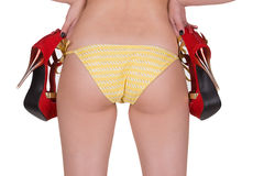 Sexy back of a beautiful woman in yellow swimming panties with shoes. Stock Images