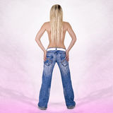 Sexy back of a blonde head woman wearing jeans Stock Photo